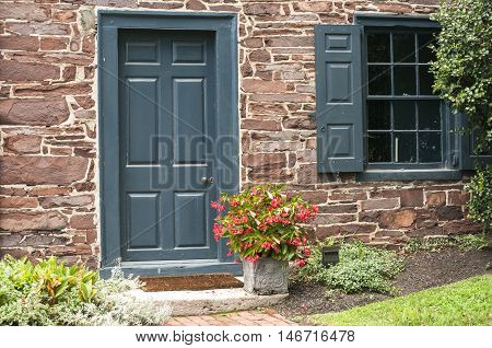 Countryside house stone wall facade with door and window