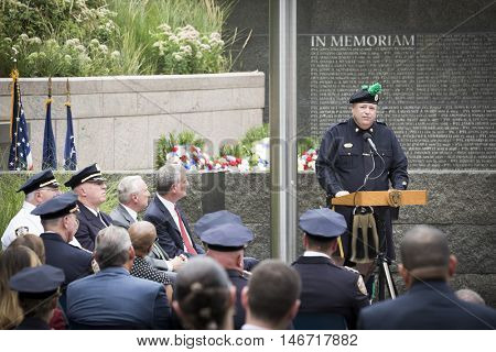NEW YORK - SEPT 9 2016: Det. Kevin McDonough, Bandmaster of NYPD Emerald Society Pipe and Drums speaks at the 9/11 Memorial Commemoration Service on the 15th anniversary of the terror attacks.