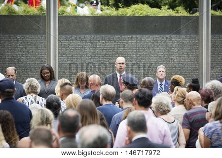 NEW YORK - SEPT 9 2016: Names of the law enforcement officers who died on September 11 or from 9/11 health-related illnesses are read at the memorial service on the 15th anniversary of the attacks.