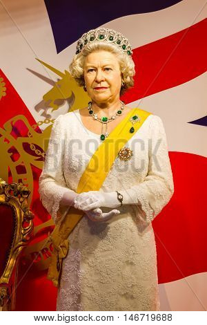 BANGKOK THAILAND - DECEMBER 19: Wax figure of the famous Queen Elizabeth from Madame Tussauds on December 19 2015 in Bangkok Thailand