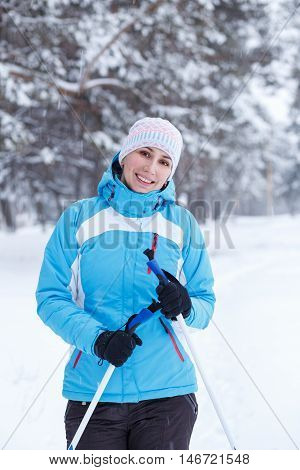 Young Athletic Woman Standing With Ski Poles