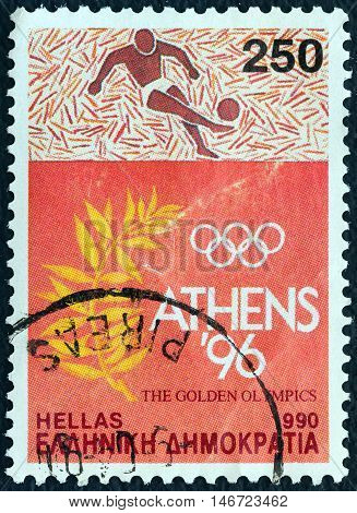 GREECE - CIRCA 1990: A stamp printed in Greece issued for Athens candidacy of 1996 summer Olympic games shows football player and olive branch, circa 1990.