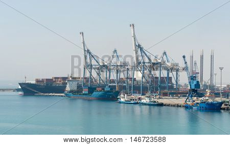Limassol Cyprus - July 29 2016: Several container ships unloading and loading their cargo at the dock of Limassol harbor in Cyprus