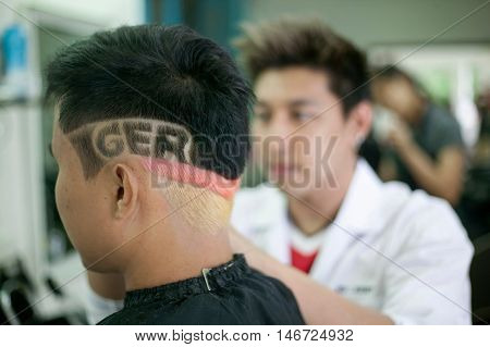 Chiang Mai, Thailand - June 10: Thai Euro Soccer Fan Have His Hair Cut And Decorated For The Soccer