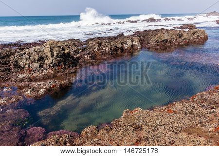 Rocky ocean coastline tidal water pools landscape.