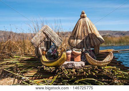 Uros Floating Islands Titicaca Peru - 30 July 2011: Indian peoples from Uros Floating islands show the reed souvenirs