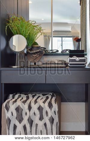 Black Wooden Dressing Table With Brown Chair And Accessories At Home