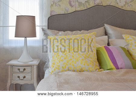 Cozy Bedroom Interior With Colorful Pillow And Bedside Table Lamp