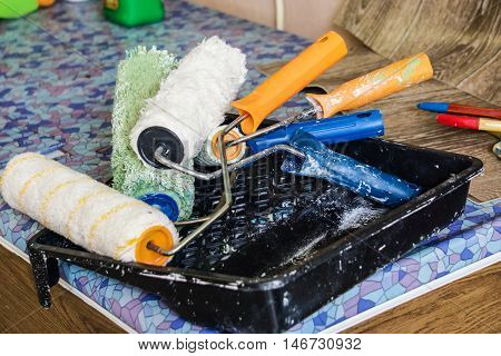 paint rollers, construction tools for painting walls