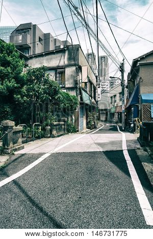 Tokyo - May 2016: Small street in residential area with skyscrapers in background. Shinjuku
