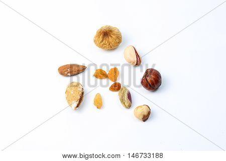 Pistachio almond macadamia nut raisins mix on white background