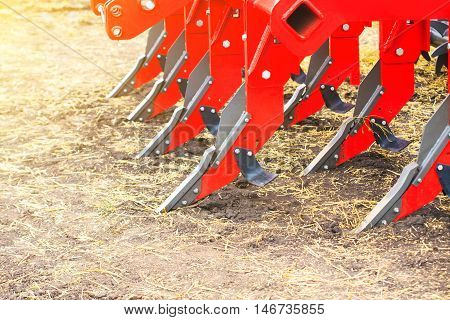 Plough close-up on the ground farm equipment