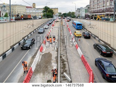 Moscow, Russia - July 14, 2016: Workers who produce renovation and repair of entry and exit road tunnel