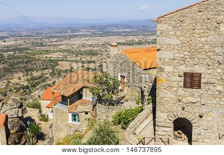 background views cityscape ancient  Monsanto village with houses made of stone among the boulders in Portugal, Europe