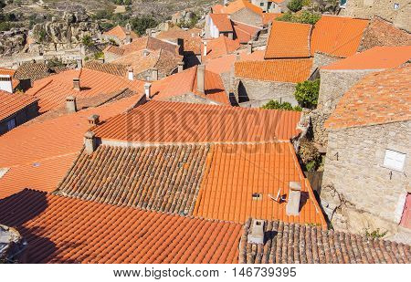 background landscape top view of red tiled roofs of the old village of Monsanto unique in Portugal