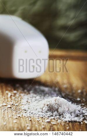 Salt On A Cutting Board Close-up Vertical