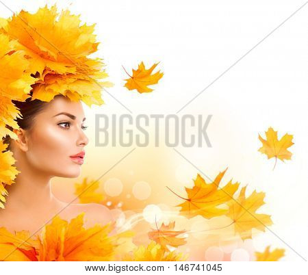 Autumn Woman, Fall. Beauty model girl with autumn bright leaves hairstyle. Beautiful Fashion female with Autumnal Make up and Hair style. Creative Autumn Makeup. Beautiful Face, isolated on white