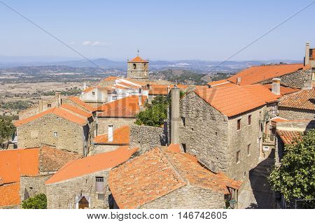 background views cityscape Monsanto village with houses made of stone among the boulders and roofs and red brick, the town hall