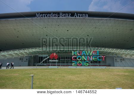 SHANGHAI CHINA - SEPTEMBER 2 2016: Attendees of Huawei Connect 2016 information technology conference near entrance to Mercedes-Benz Arena in Shanghai China on September 2 2016.