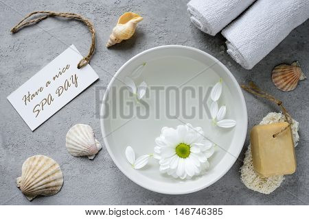 Sea spa concept with a greeting tag top view