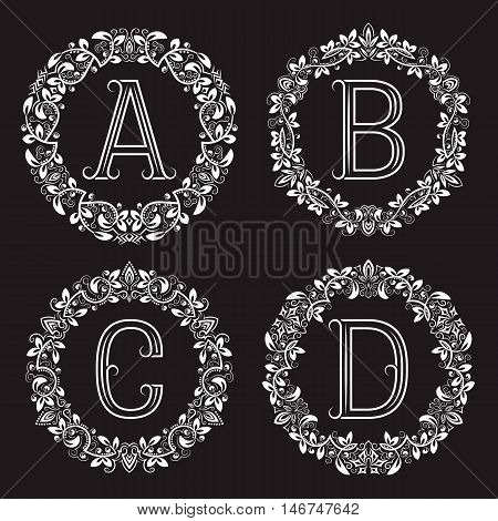 Set of vintage monograms in round wreath. A B C D white letters in floral frames.