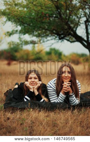Two Young Girlfriends Posing. Two Happy Friends Outdoorstwo Youn