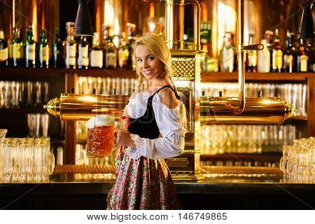 Smiling waitress with beer mugs