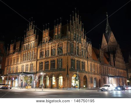 Hannover, Germany - September 9, 2016: Old Town Hall and Market Church illuminated at night.