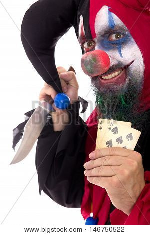 Evil Clown Holding A Knife And Playing Cards, Isolated On White