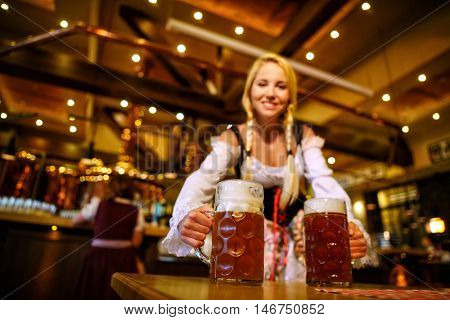 Young girl with beer mugs