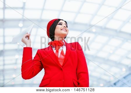 Young stewardess with a plane