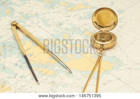 Navigation still-life. Skipper equipment, compass, ruler, protractor and a map. Sailing concept.