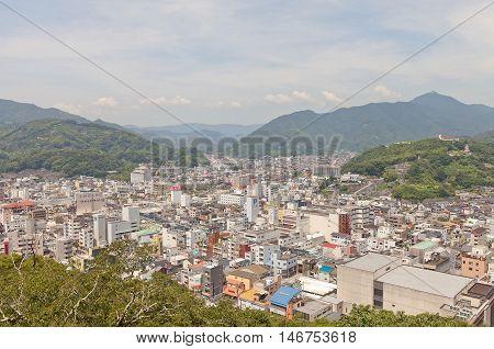 UWAJIMA JAPAN - JULY 22 2016: View of Uwajima town from main keep of Uwajima castle Shikoku Island Japan. Uwajima has developed as center city in southwest of Ehime since early 17th c