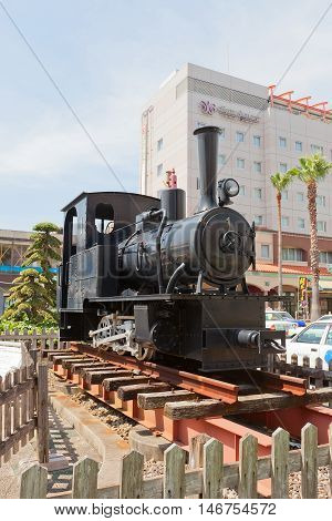 UWAJIMA JAPAN - JULY 22 2016: Steam locomotive Ke220 type on display outside Uwajima railway station Shikoku Island Japan. Made by Orenstein and Koppel OHG Company (Germany)