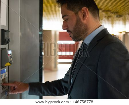 Commuter using a vending machine in a subway station