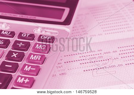calculator on book bank with tone color