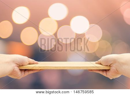Two Hand Holding Food Plate Made From Wood With Bokeh Light Background, Template Mock Up For Adding