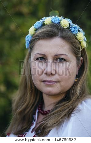 Young Beautiful Woman Posing In 40 Beautiful Floral Wreath On He