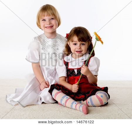 two little girls on the floor