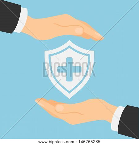 Medical insurance concept. Hands protecting shield with cross on white background. First aid and healthcare.