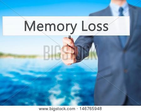 Memory Loss - Businessman Hand Holding Sign