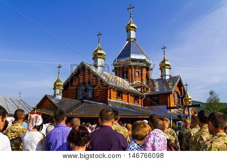 Perechin - Transcarpathia - Ukraine-11 September 2016: Worshippers pray in front of the new wooden church at the time of its consecration of the Patriarch of the Ukrainian Orthodox Church Kiev Patriarchate Filaret.