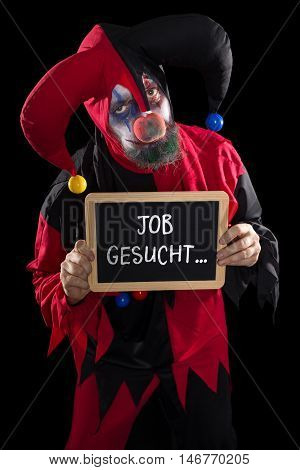 Sadly Clown Holding A Slate With German Text Job Wanted, Concept Unemployement And Job Market