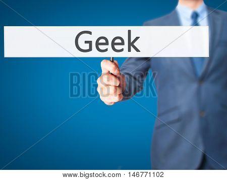 Geek - Businessman Hand Holding Sign