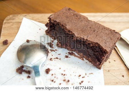 Bitten Delicious Chocolate Brownie On Wooden Tray