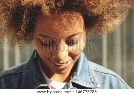 Highly-detailed Portrait Of Beautiful Dark-skinned Young Woman With Healthy Skin And Facial Piercing