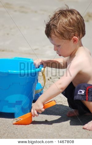 Boy Making A Sand Castle