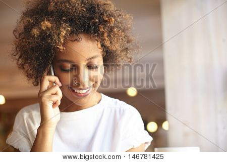 Fashionable Good-looking Black Woman With Cute Smile And Stylish Hair, Wearing White T-shirt And Nos