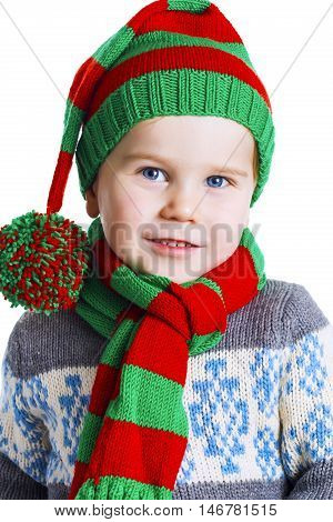 Christmas Boy In Knitted Cloths Posing