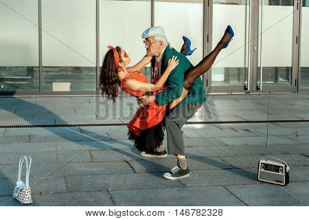 Old man dance fast dance with a young girl.